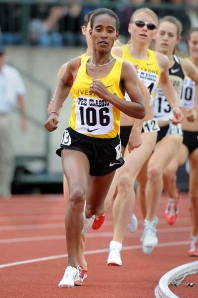 Gelete Burka (ETH) on her way to narrow 3:59.89 win over 1500m in Eugene (Kirby Lee)