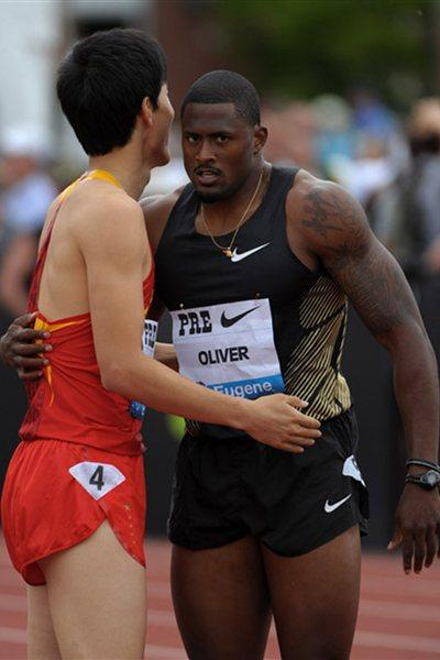 Liu Xiang and David Oliver after their epic race in Eugene in 2011 (Kirby Lee)