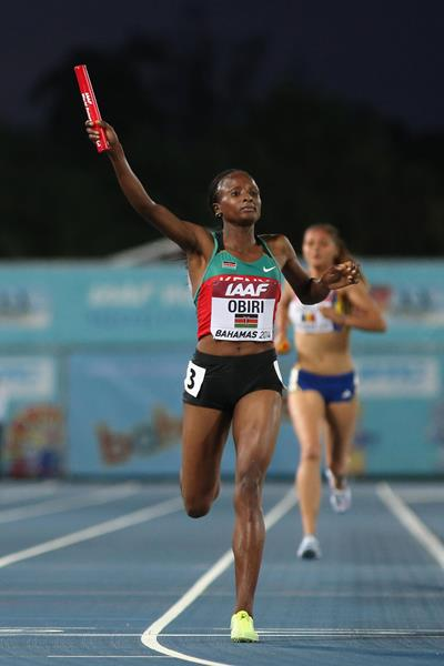 Hellen Onsando Obiri of Kenya celebrates as she crosses the finish line to win and set a new world record of 16:33.58 in the Women's 4x1500 metres relay  (Getty Images)