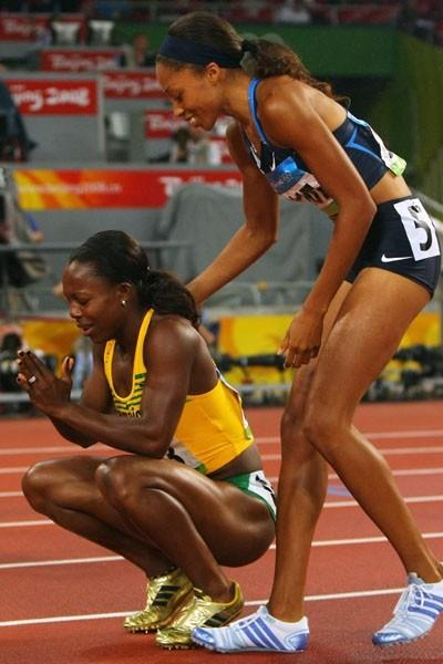 Allyson Felix congratulates Olympic champion Veronica Campbell-Brown after finishing second in Beijing (Getty Images)