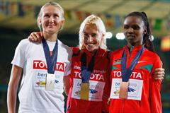 The medallists in the women's 3000m steeplechase (L-R) Yuliya Zarudneva of Russia (silver), Marta Dominguez of Spain (gold) and Milcah Chemos Cheywa of Kenya (bronze) (Getty Images)