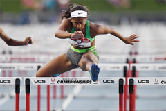 Tia Jones on her way to equalling the world U20 100m hurdles record in Clovis (Kirby Lee)
