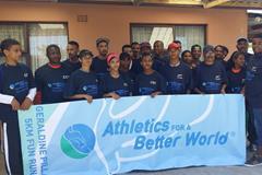 Volunteers and runners behind an ABW banner at the 2014 Geraldine Pillay 5km Fun Run (Organisers)