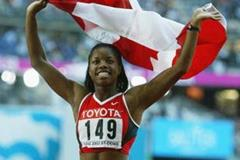 Perdita Felicien celebrates winning gold in the 100m Hurdles at the 2003 IAAF World Championships (Getty Images)