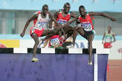 Willy Komen (c) en route to World junior Gold in Beijing (Getty Images)