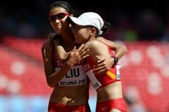 Liu Hong and Lu Xiuzhi celebrate their gold and silver medals from the 20km race walk at the IAAF World Championships, Beijing 2015 (Getty Images)