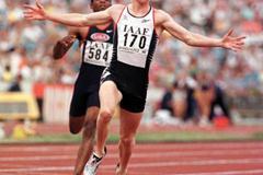 Tim Benjamin crosses the line to win the 200m (© Allsport)