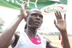Innes Chenonge crosses the finish line to win the women's 8km race at the 2010 Kenyan Armed Forces Cross Country Championships at Kahawa, Nairobi. (Elias Makori)
