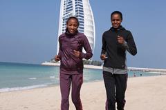 Meselech Melkamu and Meseret Hailu ahead of the 2014 Standard Chartered Dubai Marathon (Organisers / Gianfranco Colombo)