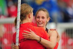 Gold medal winner Desiree SINGH of Germany is congratulated by team mate Franziska Kappes (l) after the Girls Pole Vault final - Day Four - WYC Lille 2011 (Getty Images)
