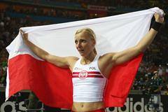 Anna Rogowska of Poland celebrates winning a suprise gold medal in the women's Pole Vault final in the Berlin Olympic Stadium during the 12th IAAF World Championships in Athletics (Getty Images)