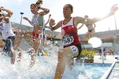 Athletes attempt to clear the water jump during the Women's 3000 metre Steepechase qualification heat on the day one of the 14th IAAF World Junior Championships in Barcelona (Getty Images)
