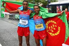Eritrea's Samuel Tsegay and Zersenay Tadese celebrate their team silver in Birmingham (Getty Images)