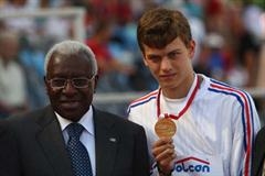Christophe Lemaitre of France receives his 200m gold medal from IAAF President Lamine Diack (Getty Images)