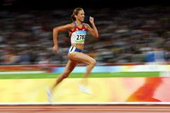 Gulnara Galkina strides towards the finish line to win steeplechase gold (Getty Images)