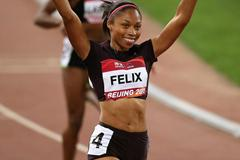 Allyson Felix celebrates her 200m victory in Beijing (Getty Images)