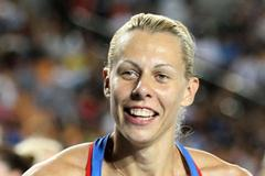 Tatyana Chernova of Russia celebrates with her country's flag after claiming gold in the women's heptathlon during day four  (Getty Images)
