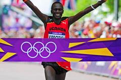 Stephen Kiprotich of Uganda celebrates as he approaches the line to win gold in the Men's Marathon the London 2012 Olympic Games at The Mall on August 12, 2012 (Getty Images)