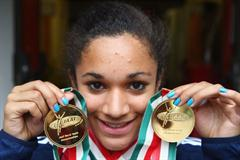 Jodie Williams of Great Britain poses with her two sprint gold medals (Getty Images)
