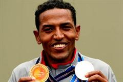 Eritrea's Zersenay Tadese with his individual gold medal and his silver team medal from the IAAF/EDF Energy World Half Marathon Championships in Birmingham (Getty Images)