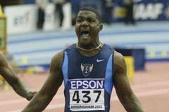 Justin Gatlin (USA) celebrates winning the men's 60m (Getty Images)