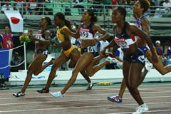 A close finish in the women's 100m final where Veronica Campbell takes gold ahead of Lauryn Williams (Getty Images)