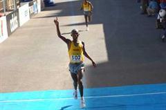 Fabiano Joseph crosses the finish line (IAAF)