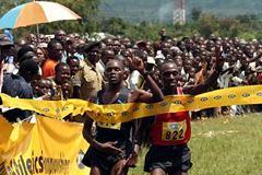 Boniface Kiprop and Moses Kipsiro both salute the win - Kiprop was declared the winner of the Ugandan XC (Daniel Senfuma)