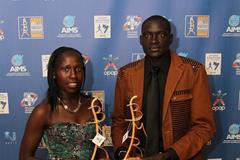 Florence Kiplagat and Dennis Kimetto with their 2014 AIMS Best Marathon Runner Awards (AIMS / Francis Kay - Marathon-Photos.com)
