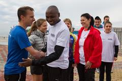 IAAF Ambassador Wilson Kipketer greeting runners after the IAAF ABW sponsored Morning Run in Sochi on 22 April 2015 (Getty Images)