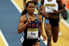 USA's Debbie Dunn wins her 400m heat in Doha (Getty Images)