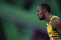 Day 1 (22/08/2015). Usain Bolt, men's 100m, round 1. EOS-1D X + EF400mm F2.8L IS II USM + EXTENDER EF1.4xIII. F4.0, 1/1600sec, ISO3200 (Takashi Okui)