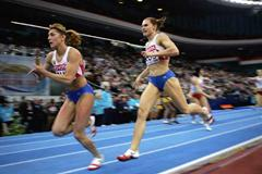 Natalya Nazarova and Olesya Krasnomovets of Russia in action during the 4x400m Relay final (Getty Images)