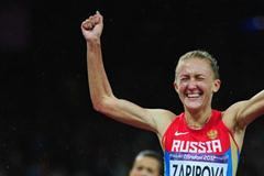 Yuliya Zaripova of Russia celebrates as she crosses the finish line to win the gold medal in the Women's 3000m Steeplechase final on Day 10 of the London 2012 Olympic Games on 6 August 2012 (Getty Images)