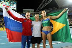 Svetlana Feofanova of Russia, Martina Strutz of Germany and Fabiana Murer of Brazil celebrate after the women's pole vault final  (Getty Images)