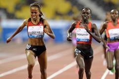 Meseret Defar is successfully defied by Vivian Cheruiyot over 3000m at the 2012 Samsung Diamond League in Doha (Jiro Mochizuki)