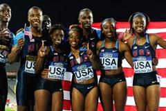 United States Woman and Men Relay teams pose after winning the gold medals on the 4x100 metres Relay Finals on the day five of the 14th IAAF World Junior Championships in Barcelona on 14 July 2012 (Getty Images)