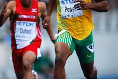 Asafa Powell of Jamaica eases across the line to achieve an automatic qualifying mark in the men's 100m heats (Getty Images)