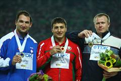 Silver medalist Primoz Kozmus of Slovenia, gold medalist Ivan Tsikhan of Belarus and bronze medalist Libor Charfreitag of Slovakia pose on the podium after receiving their medals in the Men's Hammer Throw Final (Getty Images)