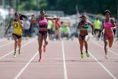 English Gardner (left) on her way to a PB of 11.00 in the 100m at the 2013 Mt SAC Relays (Kirby Lee)