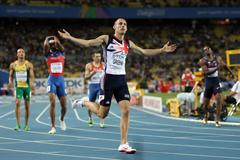 David Greene of Great Britain celebrates after crossing the finish line and claiming gold in the men's 400 metres hurdles final (Getty Images)