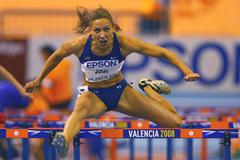 Lolo Jones on her way to winning the women's 60m hurdles (Getty Images)