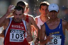 Perez and Andreyev in Torino 2002 (Peter Thompson AMS-IAAF)