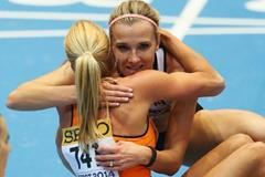 Brianne Theisen Eaton congratulates Nadine Broersen after the pentathlon 800m at the 2014 IAAF World Indoor Championships in Sopot (Getty Images)