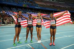 (L-R) Allyson Felix, Bianca Knight, Marshevet Myers and Carmelita Jeter of the USA celebrate victory in the women's 4x100 metres relay final  (Getty Images)