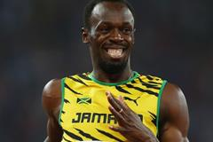 Usain Bolt after anchoring Jamaica to gold in the 4x100m at the IAAF World Championships, Beijing 2015 (Getty Images)