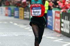 Silver medallist Bernard Kipyego celebrates as he crosses the finish line in Birmingham (Getty Images)