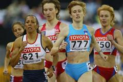Kelly Holmes of Great Britain in action in the heats of the 1500m (Getty Images)