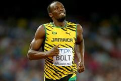 Usain Bolt wins his 200m heat at the IAAF World Championships, Beijing 2015 (Getty Images)