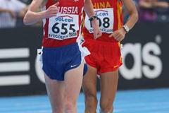 Stanislav Emelyanov of Russia on his way to victory followed by Ding Chen of China during the Final Men's 10,000m Race Walk (Getty Images)